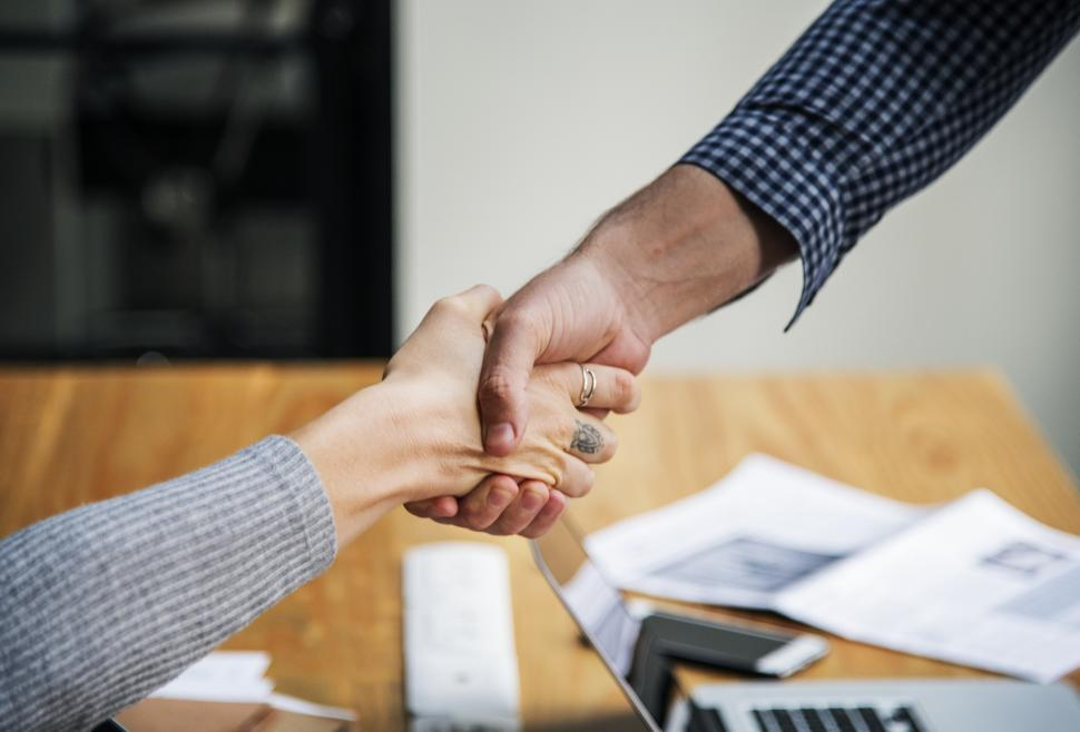 Download Free Stock HD Photo of Closeup handshake between two business people Online