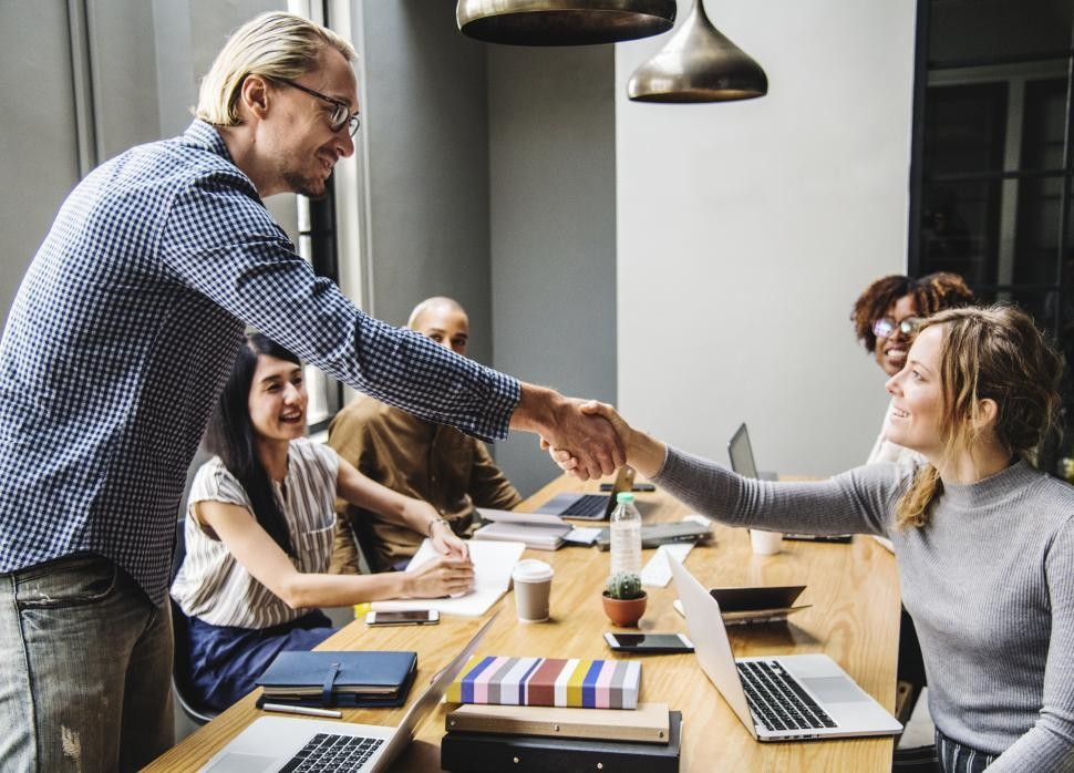 Download Free Stock HD Photo of Friendly handshake between two business people Online