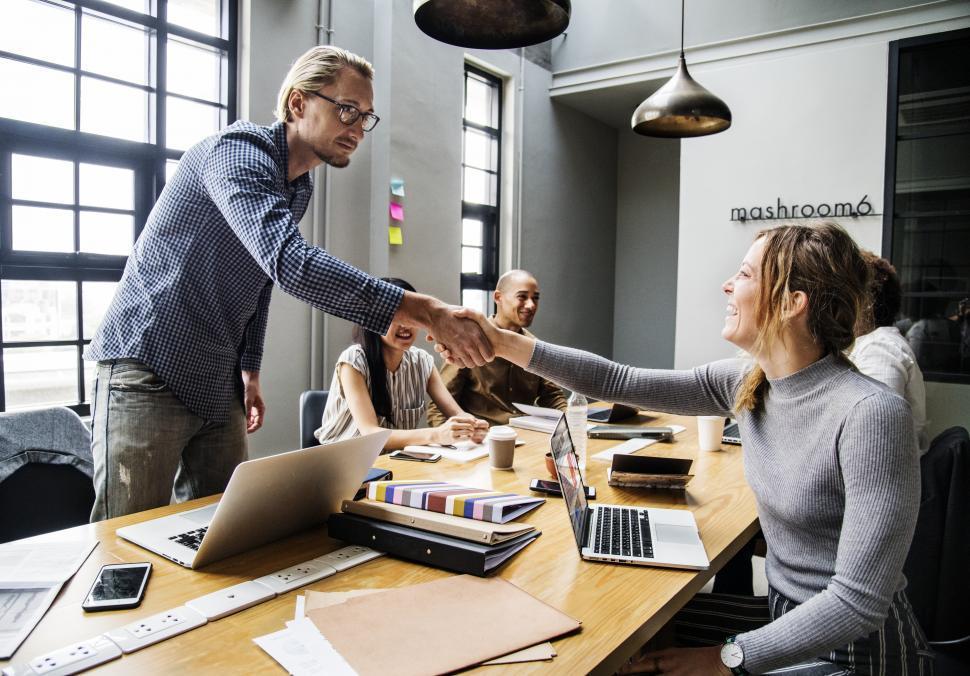 Download Free Stock HD Photo of Handshake across table between two business people Online
