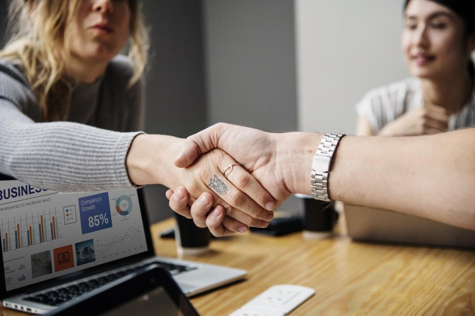 Download Free Stock HD Photo of Handshake close up over conference table Online