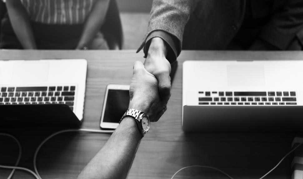 Download Free Stock HD Photo of Two business people shake hands - black and white Online