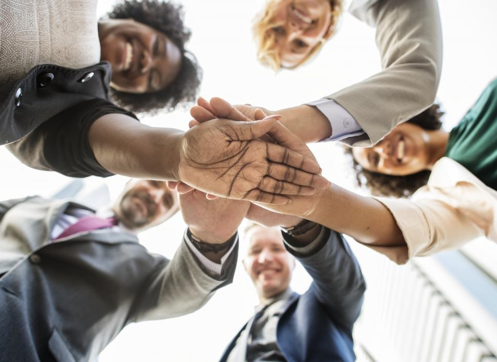 Download Free Stock HD Photo of Group of people with hands in the middle - huddle Online