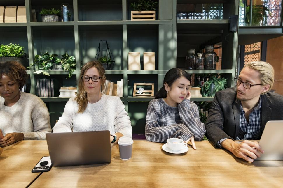 Download Free Stock HD Photo of Working together at a cafe Online