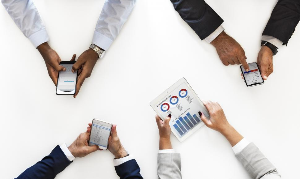 Download Free Stock HD Photo of Overhead view of businesspeople operating mobile phones Online