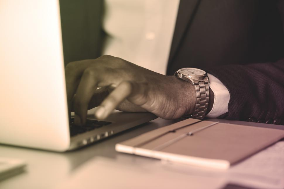 Download Free Stock HD Photo of Close up of a businessman working on laptop Online