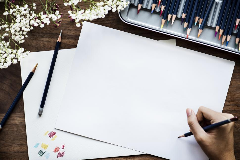 Download Free Stock HD Photo of Overhead view of a hand drawing on white paper Online