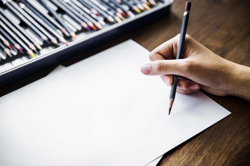 Download Free Stock HD Photo of Overhead view of a hand drawing on white sheet of paper Online