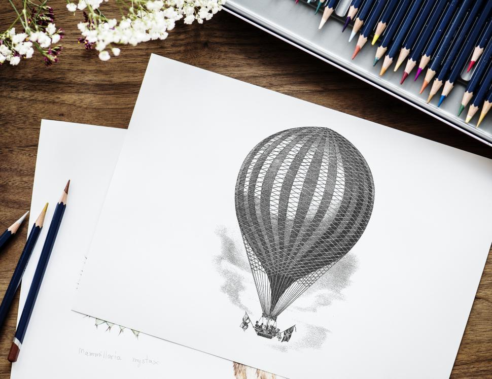 Download Free Stock HD Photo of Flat lay of a sketch of hot air balloon with color pencils Online