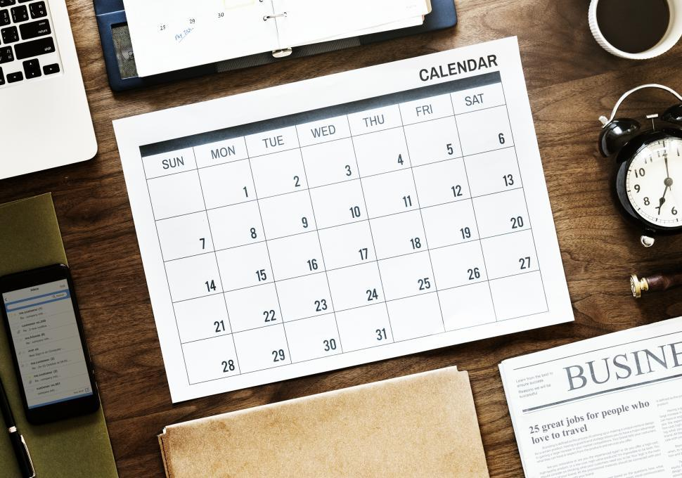 Download Free Stock HD Photo of Flat lay of a calendar on the table Online