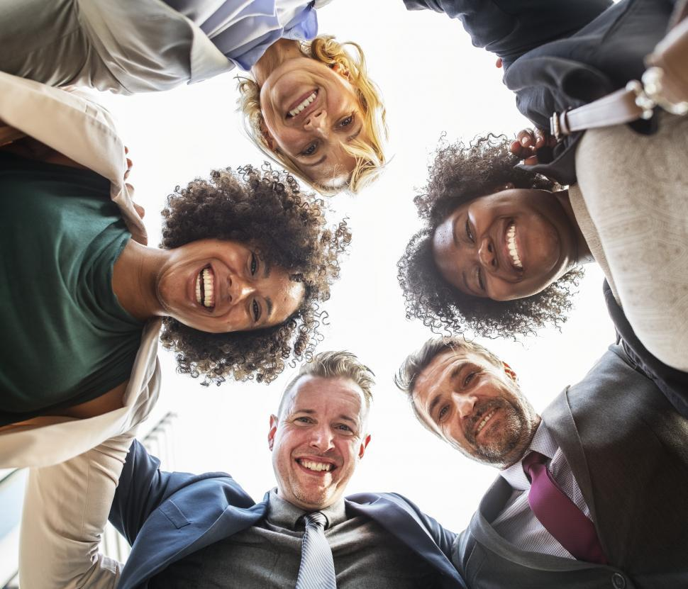 Download Free Stock HD Photo of Low angle view looking up at a team huddle of happy colleagues  Online