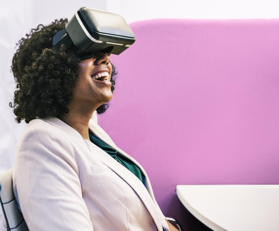 Download Free Stock HD Photo of Virtual reality experienced by happy woman Online