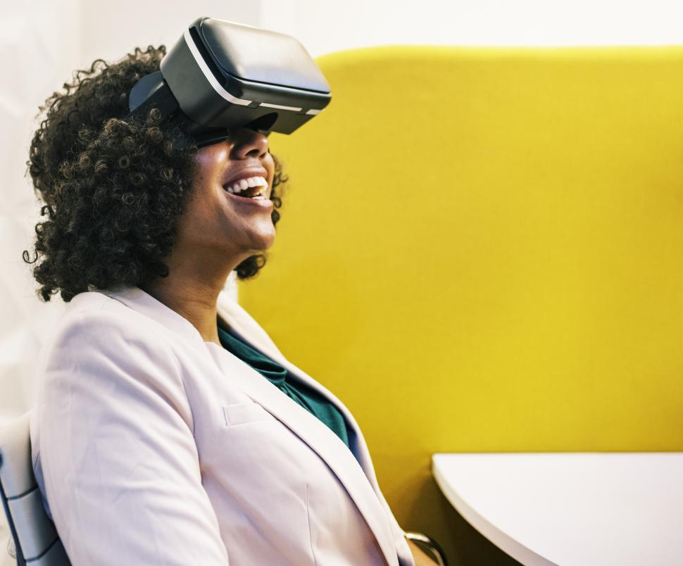 Download Free Stock HD Photo of Woman experiencing virtual reality with headset Online