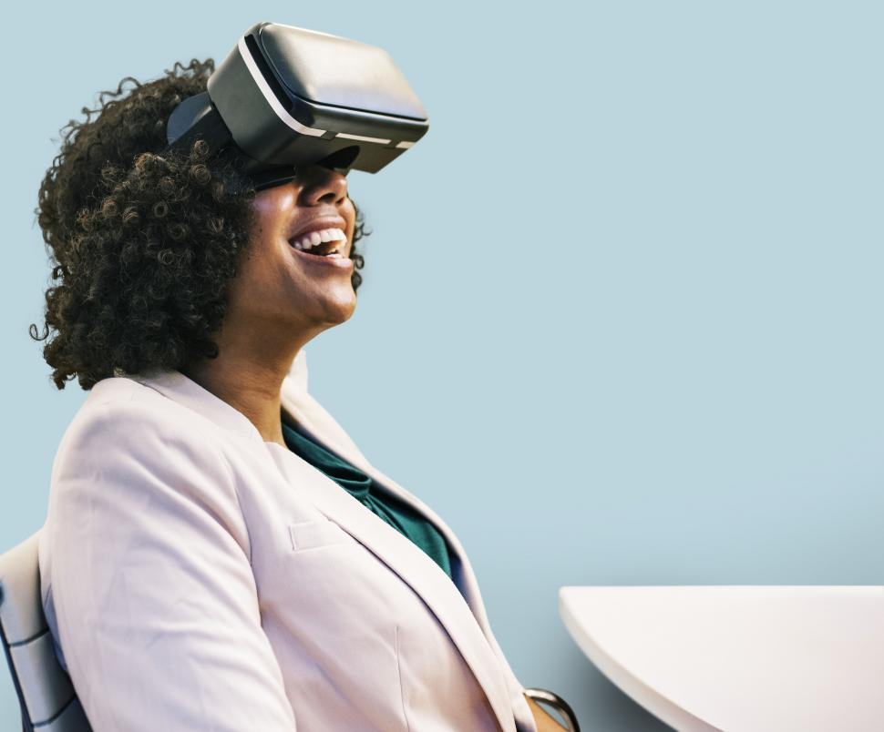 Download Free Stock HD Photo of Happy woman wearing a virtual reality headset Online