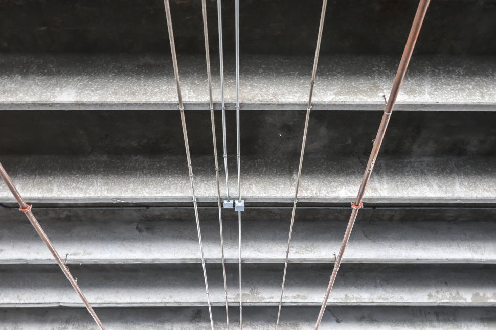 Download Free Stock HD Photo of Electrical Conduit on Concrete Beams Online