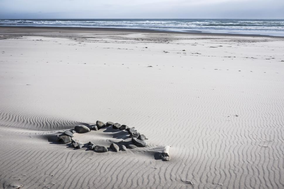Download Free Stock HD Photo of Circle of stones on the beach Online