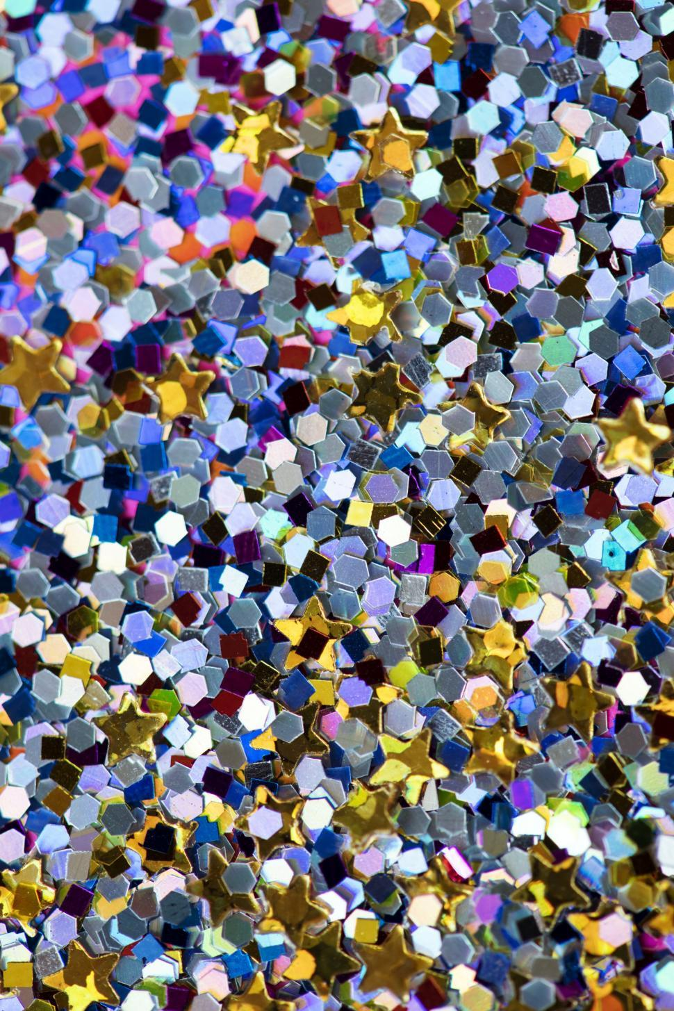 Download Free Stock HD Photo of Blue, yellow and violet hexagonal and star shaped glass glitter sparkles Online