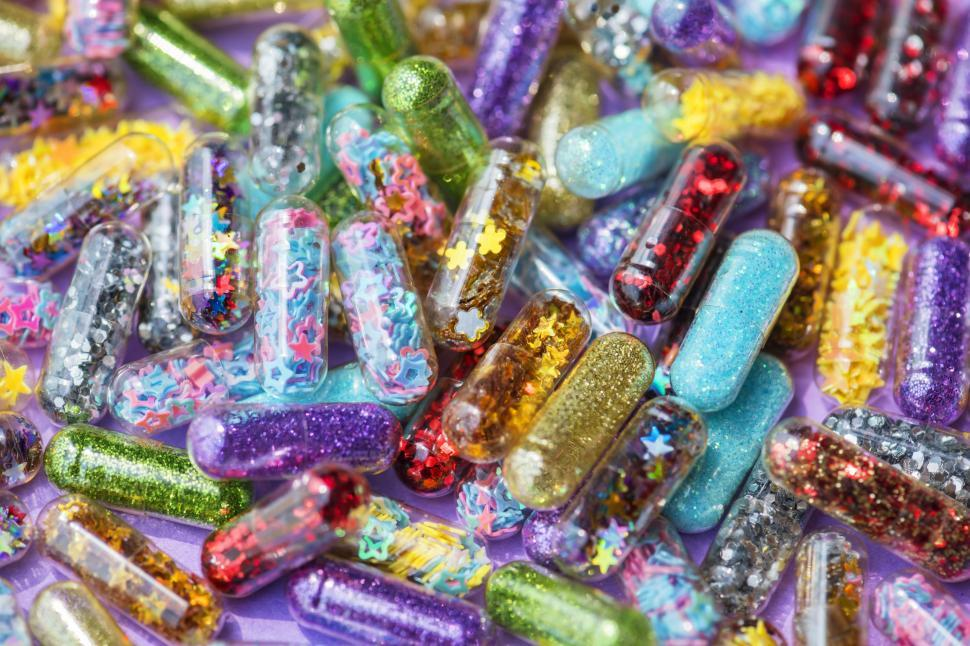 Download Free Stock HD Photo of Close up of colorful glitter pills Online