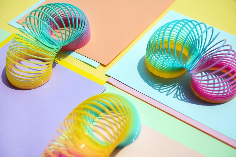 Download Free Stock HD Photo of Close up of colorful slinky toys Online