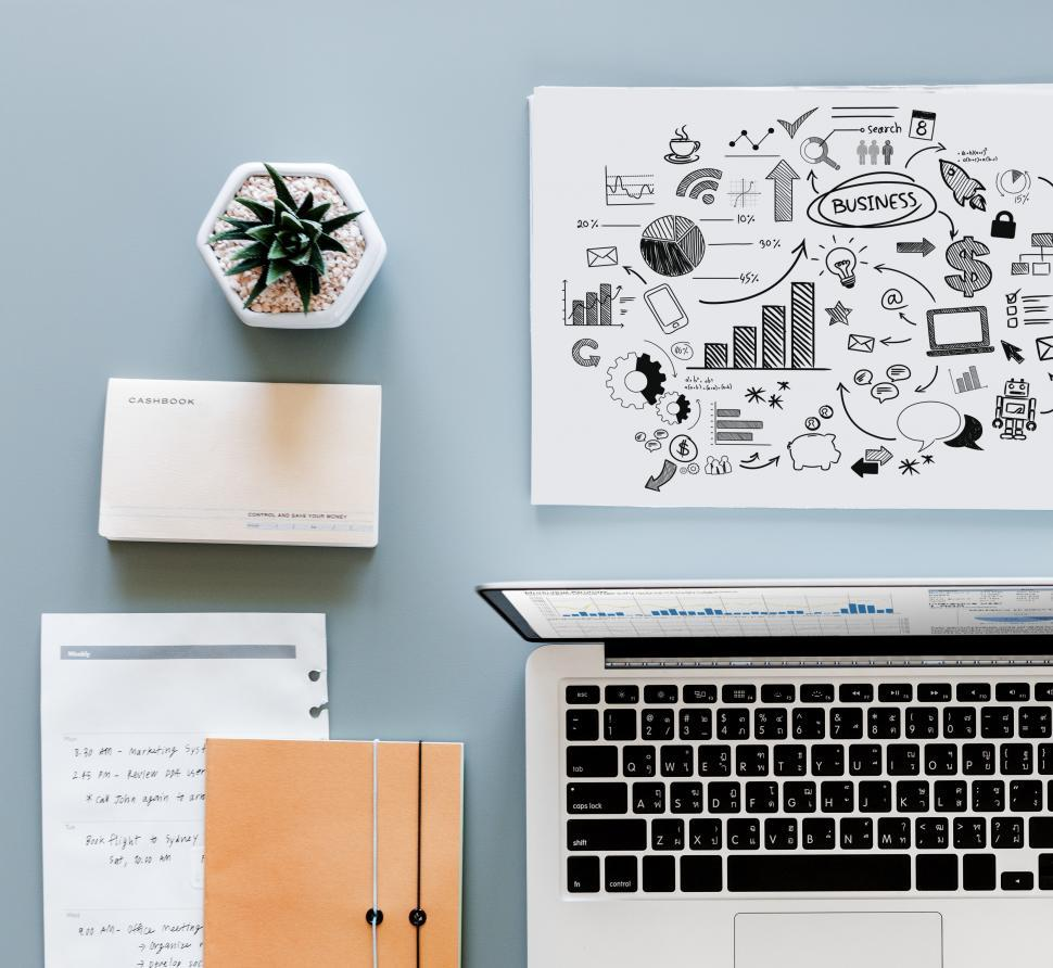 Download Free Stock HD Photo of Workspace with laptop surrounded with other items on the office table Online