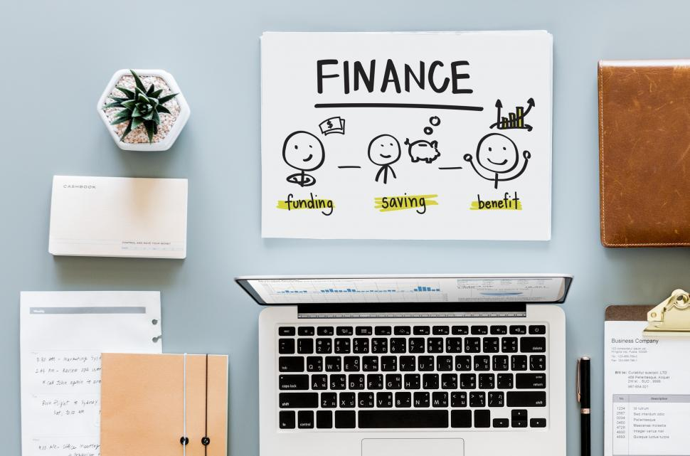 Download Free Stock HD Photo of Overhead view of laptop and Finance graphic in workspace Online