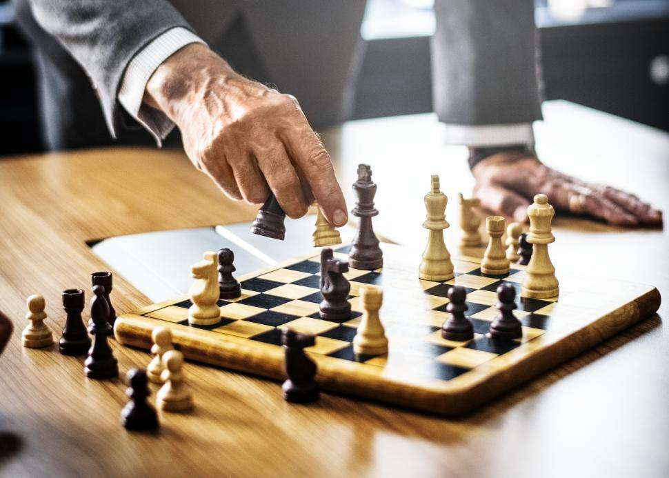 Download Free Stock HD Photo of Close up of a person s hand playing chess Online