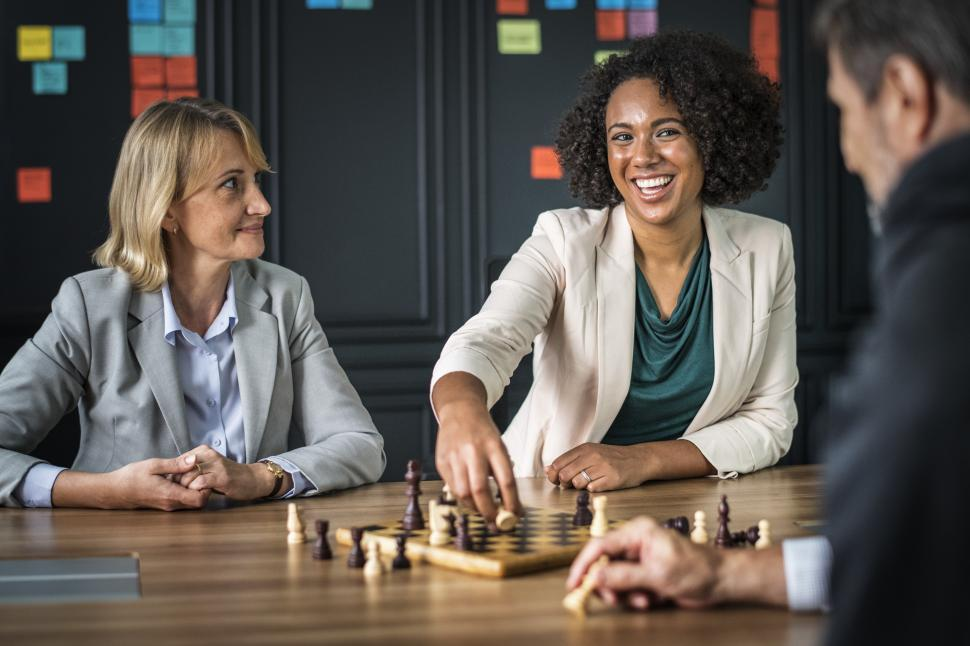 Get Free Stock Photos of Three business people playing chess Online