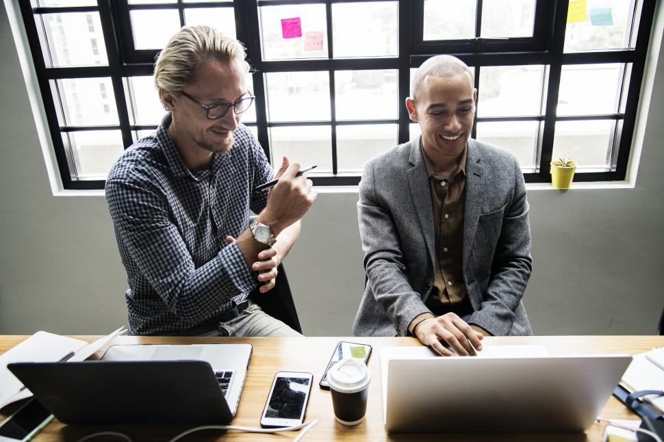 Download Free Stock HD Photo of Two male colleagues in the office with computers Online