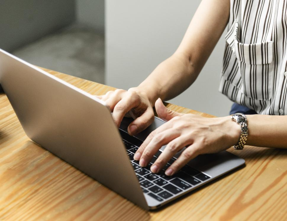Download Free Stock HD Photo of Close up of  hands typing on the laptop Online