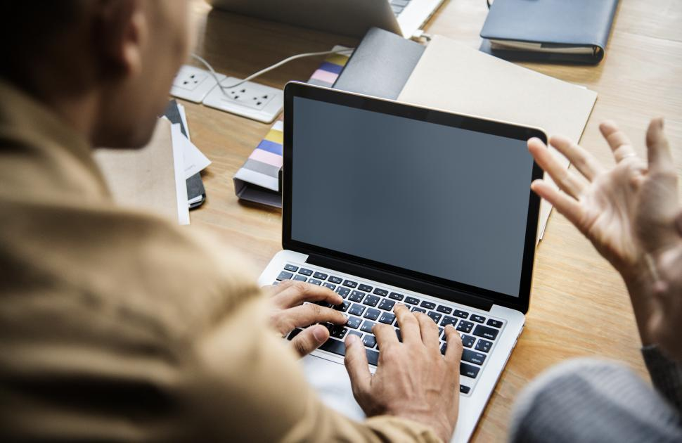 Download Free Stock HD Photo of Close up of a person working on laptop with blank screen Online