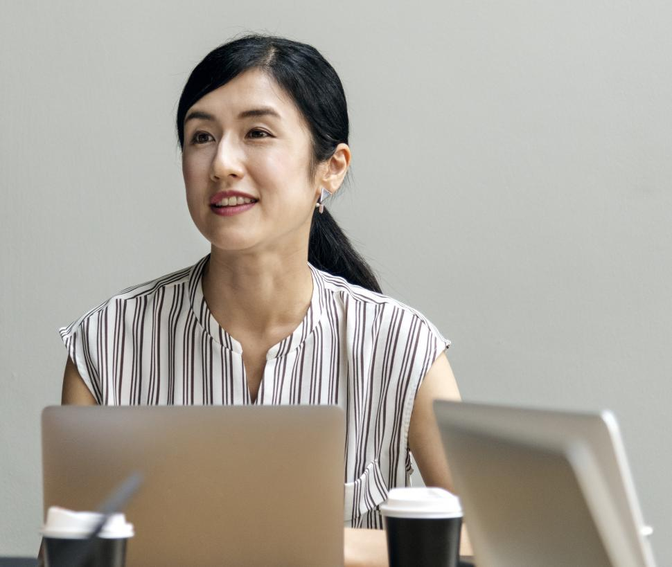 Download Free Stock HD Photo of Young woman at computer in group meeting Online