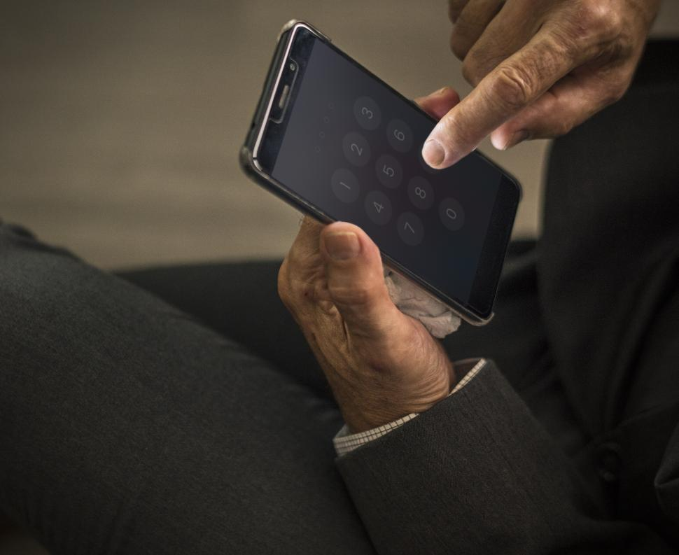 Download Free Stock HD Photo of Close up of hands interacting with a mobile phone screen Online