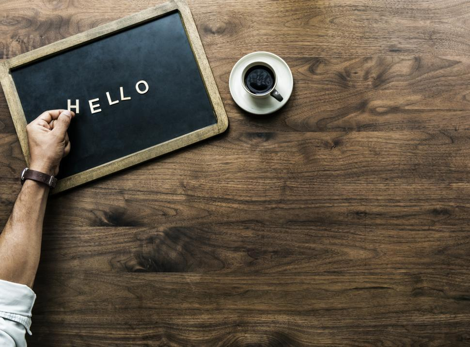 Download Free Stock HD Photo of Overhead view of the word HELLO laid out by plastic alphabet blocks on a slate Online