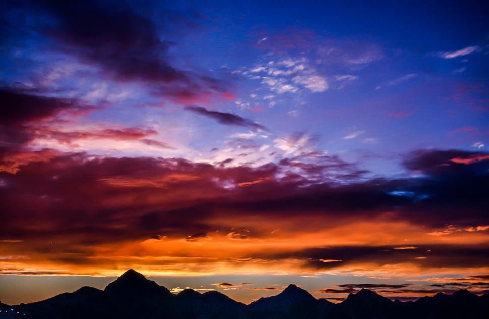 Download Free Stock HD Photo of Colorful Sunset Sky Over Mountains Online