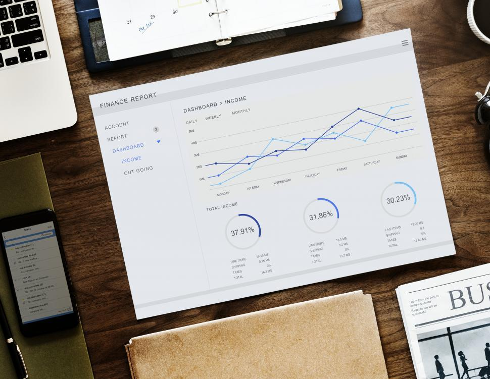 Download Free Stock HD Photo of Flat lay of a laptop along with charts on the office table Online