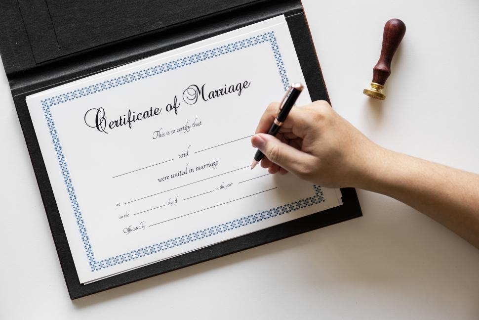 Download Free Stock HD Photo of Writing on the Certificate of Marriage - signature Online
