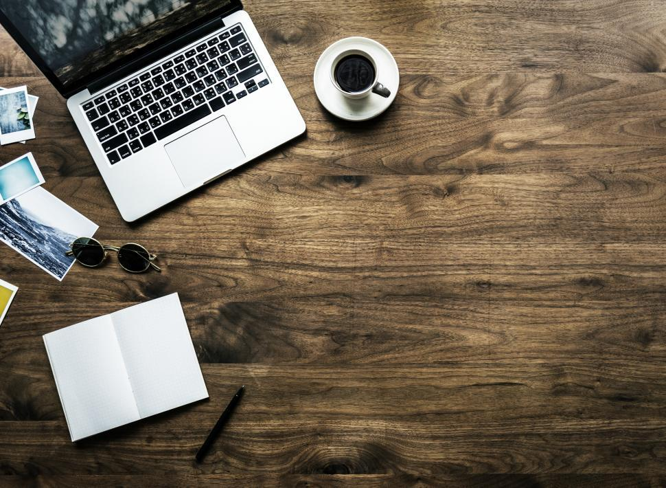 Download Free Stock HD Photo of Overhead view of a laptop on the table with copyspace Online