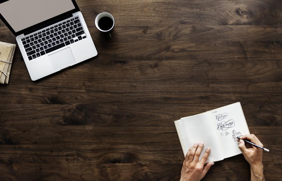 Download Free Stock HD Photo of Overhead view of hands writing on a notebook with copyspace Online