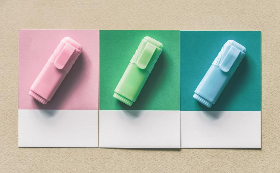 Download Free Stock HD Photo of Flat lay of three highlighters on three spaced color sample squares Online