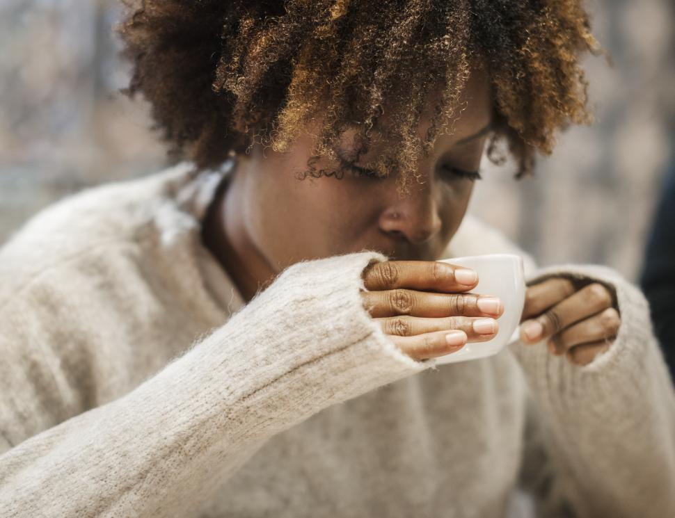Download Free Stock HD Photo of Close up of an African ethnicity woman drinking coffee Online