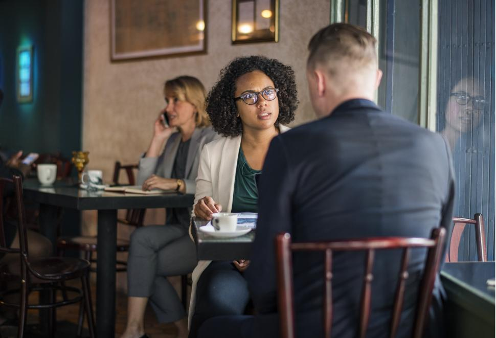 Download Free Stock HD Photo of Two businesspeople at a cafe Online