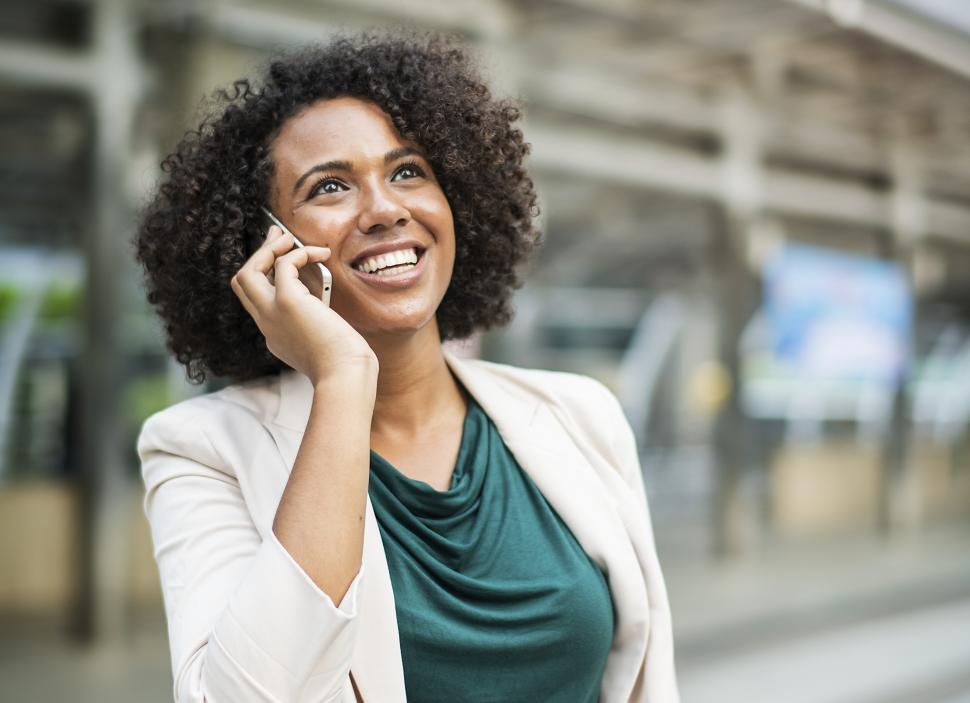 Download Free Stock HD Photo of A young woman speaking on the mobile phone in the street Online