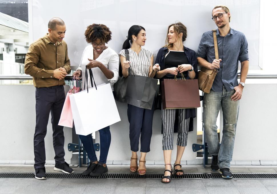 Download Free Stock HD Photo of A group of multiethnic shoppers with bags of purchases Online
