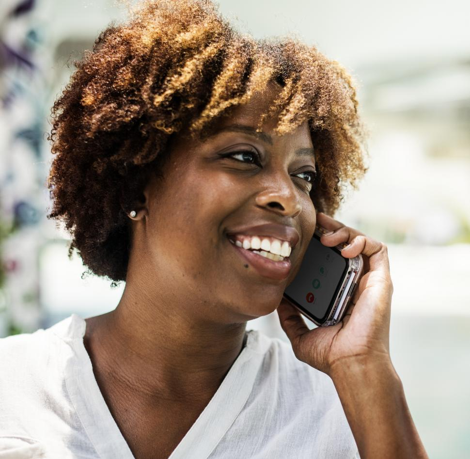 Download Free Stock HD Photo of A young woman of African origin speaking on the mobile phone Online