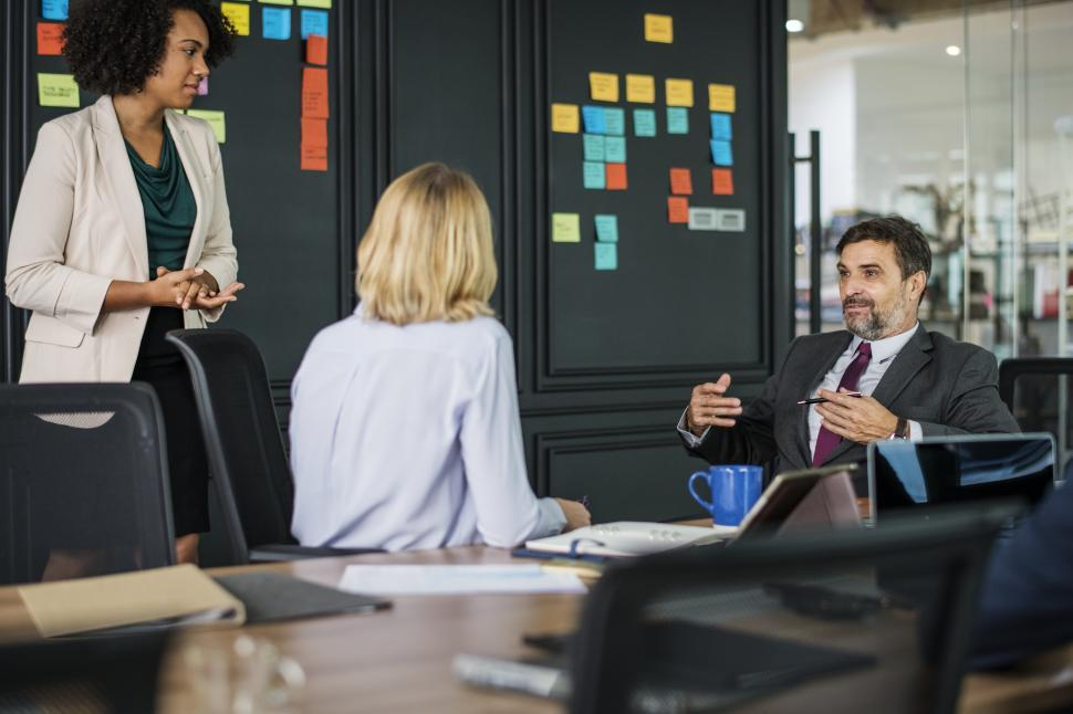 Download Free Stock HD Photo of A group of colleagues in a meeting with sticky notes Online