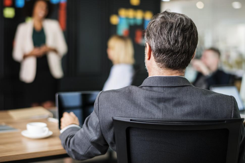Download Free Stock HD Photo of Back of a man watching colleagues in a meeting Online