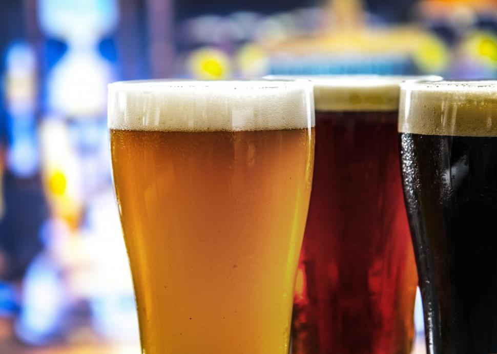 Download Free Stock HD Photo of Close up of various beers served in pint glasses Online