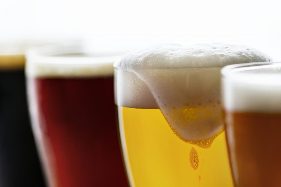 Download Free Stock HD Photo of Close up of beer foam spilling over lip of glass Online