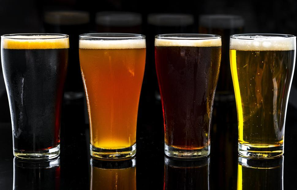 Download Free Stock HD Photo of Dramatic close up of beer served in pint glasses Online
