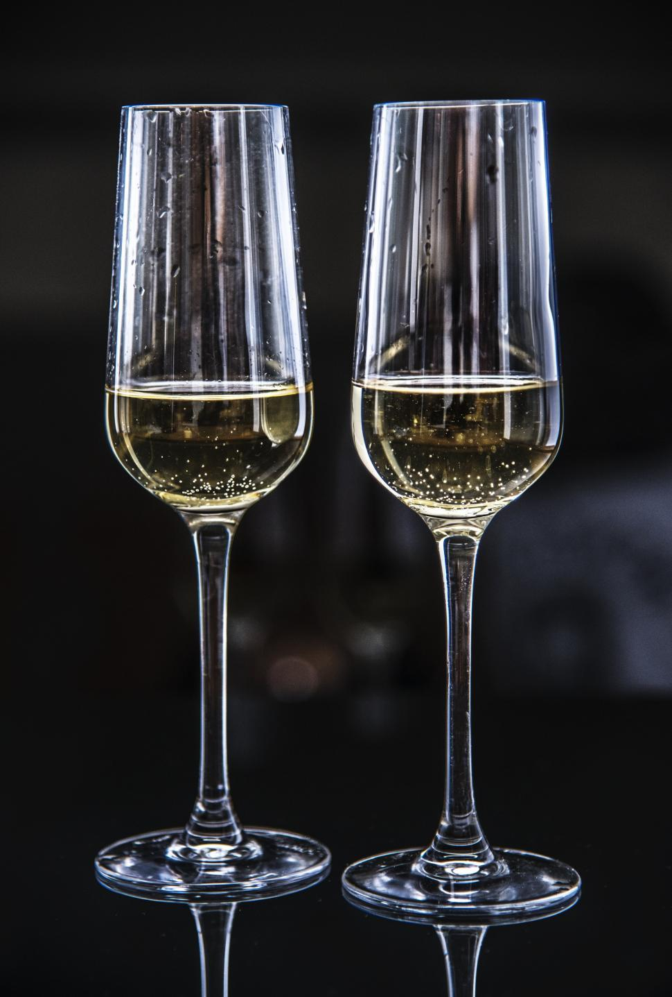 Download Free Stock HD Photo of Close up of two partially filled champagne glasses Online