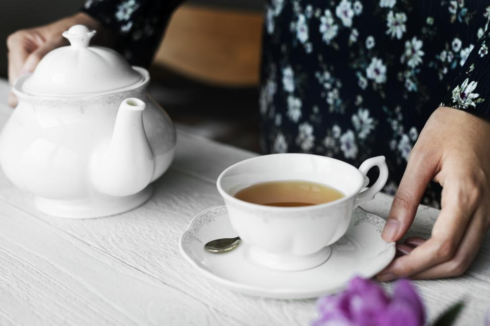 Download Free Stock HD Photo of Close up of a woman with tea and teapot Online